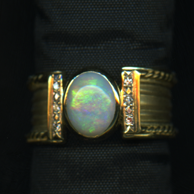 RING - OPAL 9X7 - 18KY -SIZE 7+, WITH SMALL DIAMONDS.